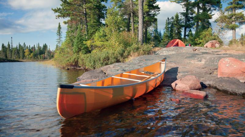 Canoe on the rocky shore of a campsite